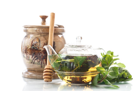 tea with honey and mint on a white background photo