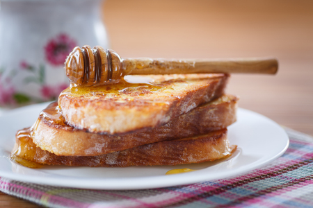 sweet toast with honey on a wooden table photo