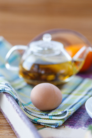 boiled egg with hot tea for breakfast photo
