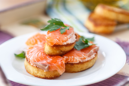 Fried toast with salted salmon and greens photo