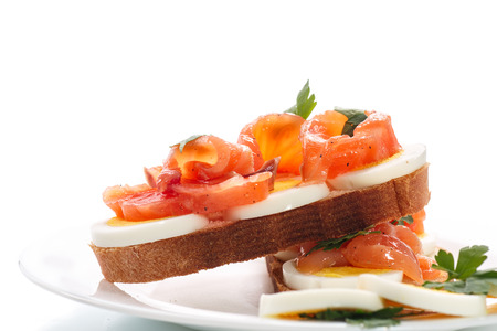 sandwich with egg and salmon on white background photo
