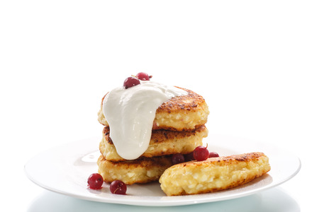 curd cheese pancakes fried with  berries on a white background photo