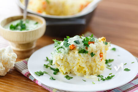 vegetable casserole with rice and cauliflower sauce photo