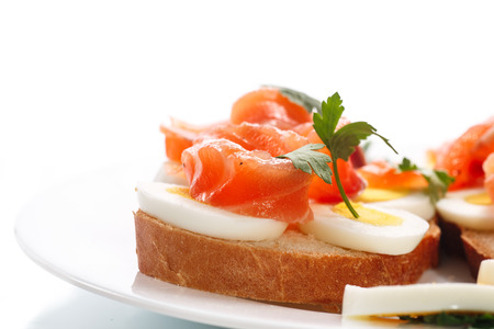sandwich with egg and salmon on white  photo