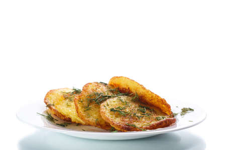 potato pancakes with dill on a plate photo
