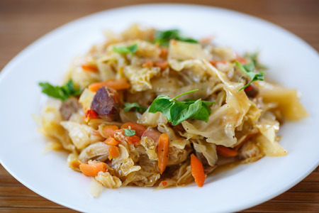 cabbage stew with carrots on a plate Standard-Bild
