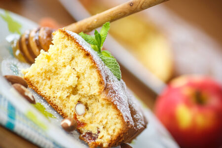 sponge cake with dried apricots, almonds and fruit photo