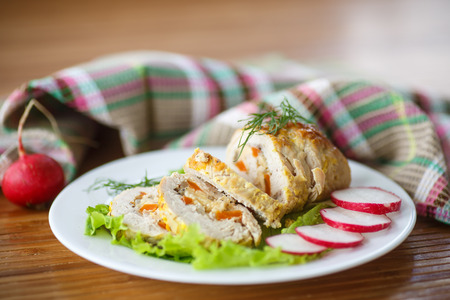 chicken roulade stuffed with meat on lettuce photo