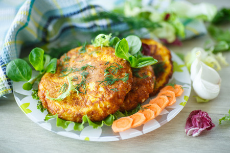 fritters: carrot fritters with herbs on a plate
