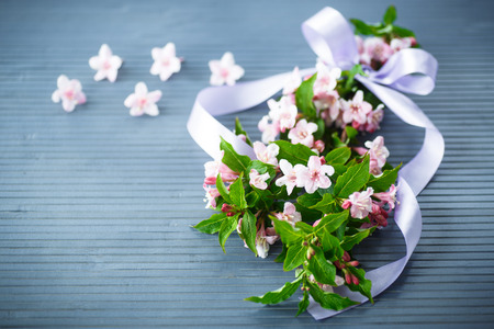 Weigel beautiful pink flowers on wooden table photo
