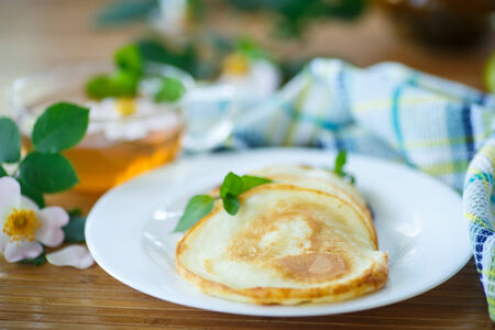 browns: sweet delicious pancakes with tea for breakfast Stock Photo