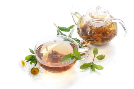 tea of chamomile flowers on white  photo