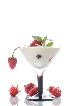 milk with strawberry jelly in glasses on white background photo