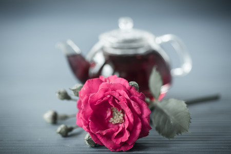 tea filter: fresh tea from rose petals on the wooden table. filter effect of old photos