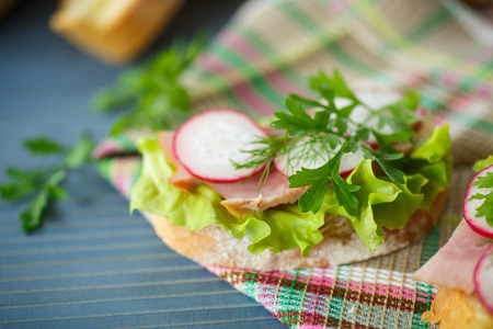 sandwich with lettuce, ham and radish for breakfast photo
