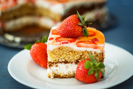 honey cake with strawberry and red currant photo