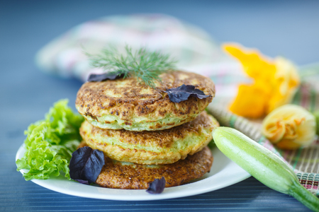 fried zucchini fritters with dill on a plate Reklamní fotografie