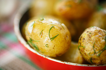 roasted new potatoes in a pan on the table