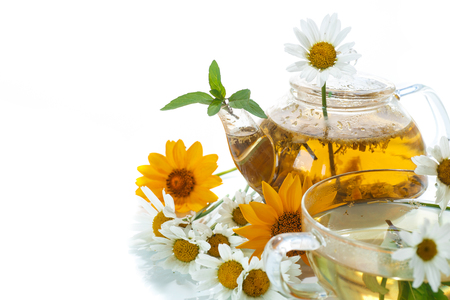 Chamomile herbal tea with flowers on a white background photo