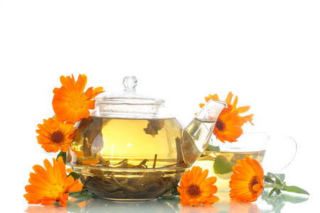 Calendula tea in a cup on a white background photo