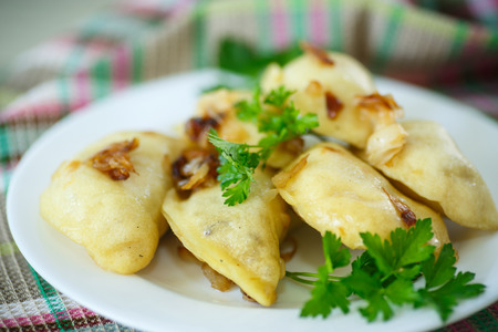 dumplings stuffed with a plate on the dining table 写真素材