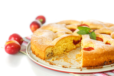 Biscuit cake with cherry plums and nuts photo