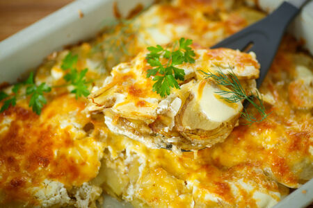 prepared potato: new potatoes baked with cheese in baking dish