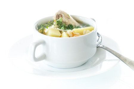 chicken soup: chicken soup with noodles in a bowl on a white background Stock Photo