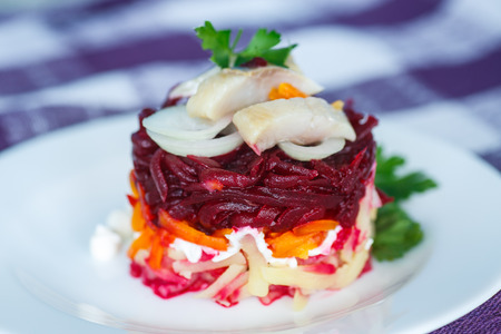 Russian traditional salad with herring and boiled vegetables
