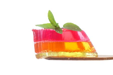 multi-layered fruit jelly isolated on white background photo