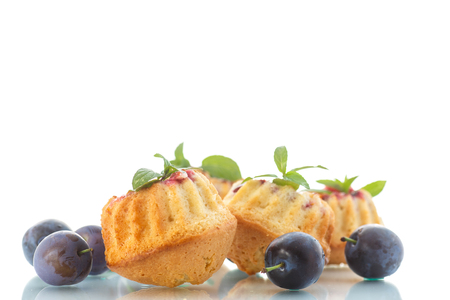 sweet plum muffins on a white background photo