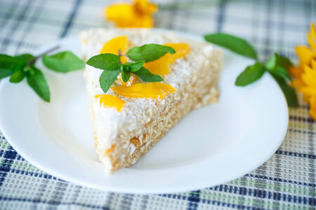 Waffle cake with peaches and cream decorated with mint photo