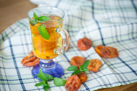 preservatives: compote with dried apricots and mint sprig Stock Photo