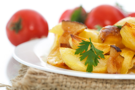 fried potatoes with slices of bacon on a white background photo