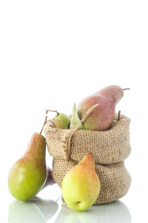 ripe pears in a bag on a white background photo