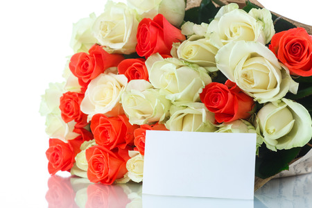 bouquet of red and yellow roses on a white background