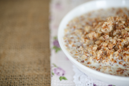 buckwheat porridge cooked with milk and butter photo