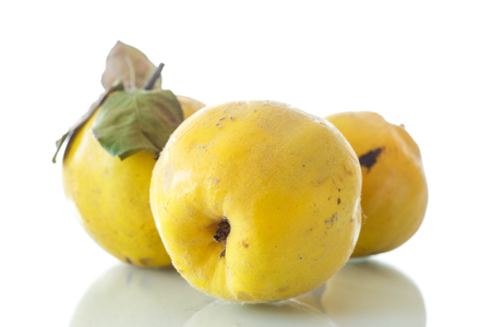 natural organic ripe quince on a white background photo