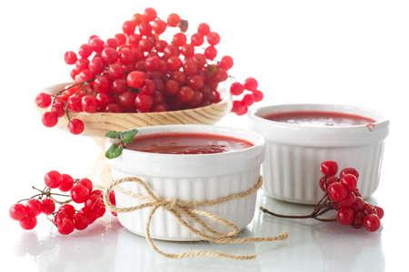 guelder rose: guelder rose jam with fresh sweet viburnum on a white background