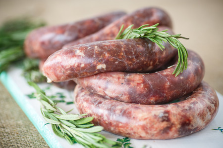 hepatic: home hepatic raw sausage with rosemary on a table Stock Photo