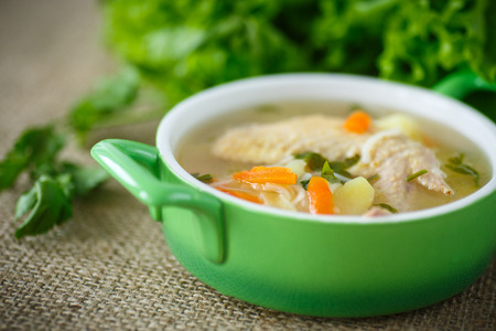 meat soup: chicken soup with noodles in a bowl