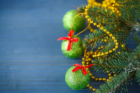Christmas tree with ornaments  on the wooden table photo