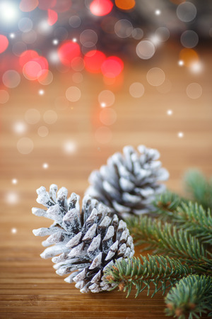 Christmas tree with cones on an abstract background photo