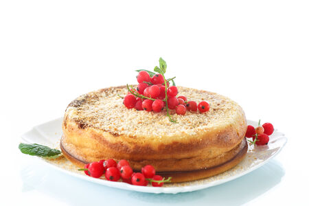 sweet curd pudding with berries on a white background photo