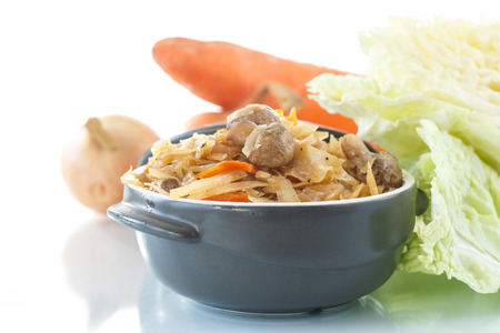 braised mushrooms: Braised cabbage with carrots and mushrooms on a white background