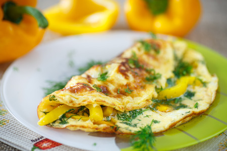 delicious omelet with peppers and herbs on a plate 写真素材