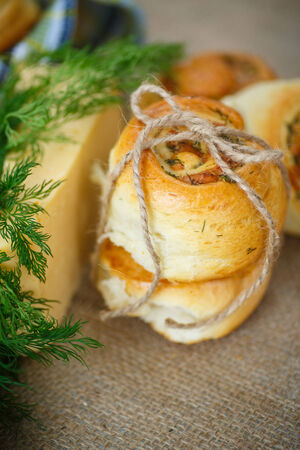 mini pizza: baked buns stuffed with cheese and herbs