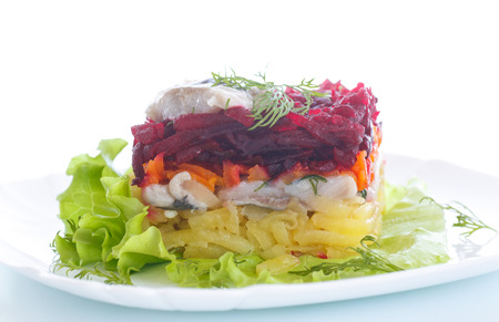 Russian traditional salad with herring and boiled vegetables photo