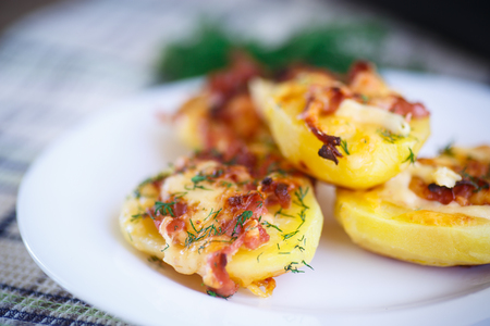 potatoes baked with bacon, cheese and dill photo