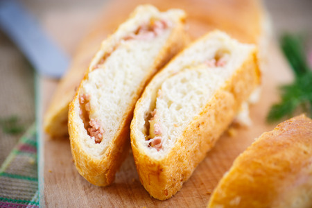 baked bread stuffed with cheese and sausage photo